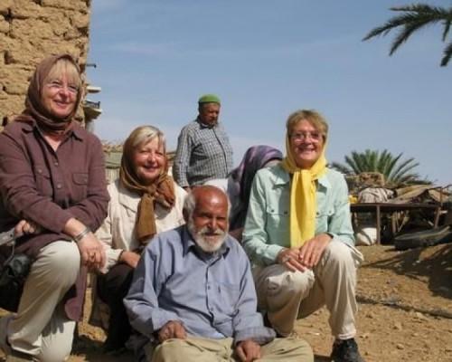 travelers in iran desert